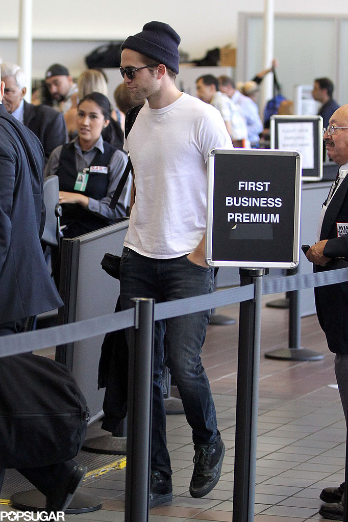 Robert Pattinson made his way through security.