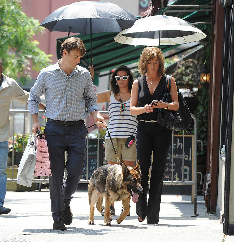Jennifer Aniston and Will Forte were followed by personal umbrella holders on the NYC set of Squirrels to the Nuts.