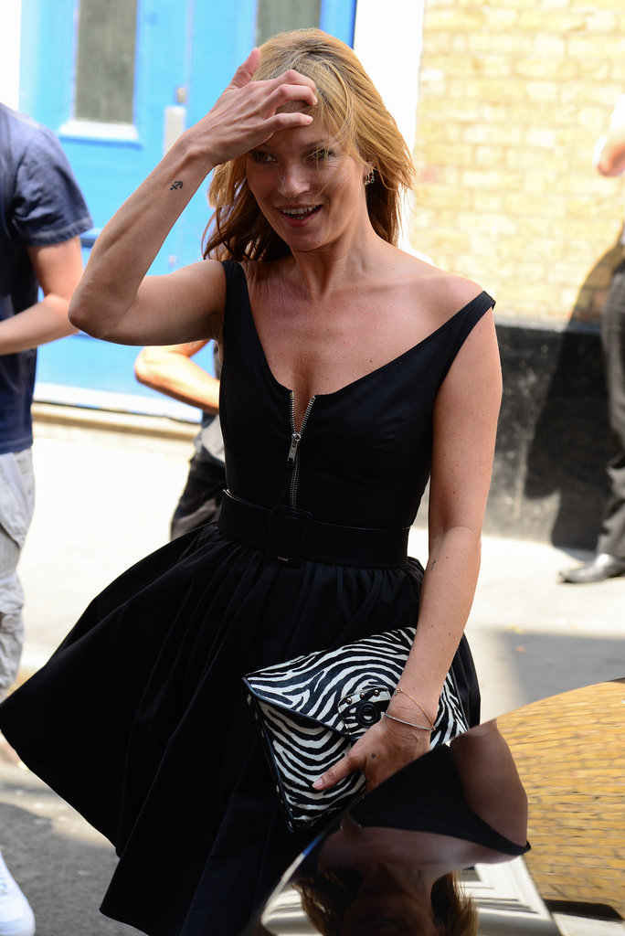 Kate Moss laughed off her dress incident before heading into The Ivy Club.