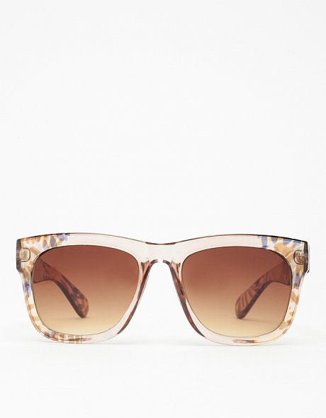 The best way to accessorize tanned Summer skin? Neutral-hued sunnies of course,