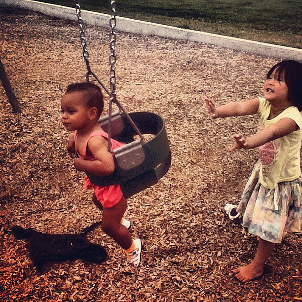 Naleigh Kelley gave her little sister, Adalaide, a push on the swing in the park. Source: Instagram user  josh_kelley