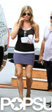 Jennifer Aniston carried a beverage and chatted with a crew member on July 19.
