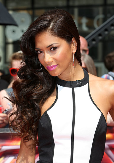 At the London auditions for X Factor, Nicole Scherzinger wore sideswept waves and brought Summer style to the look with a fluorescent pink lip color.