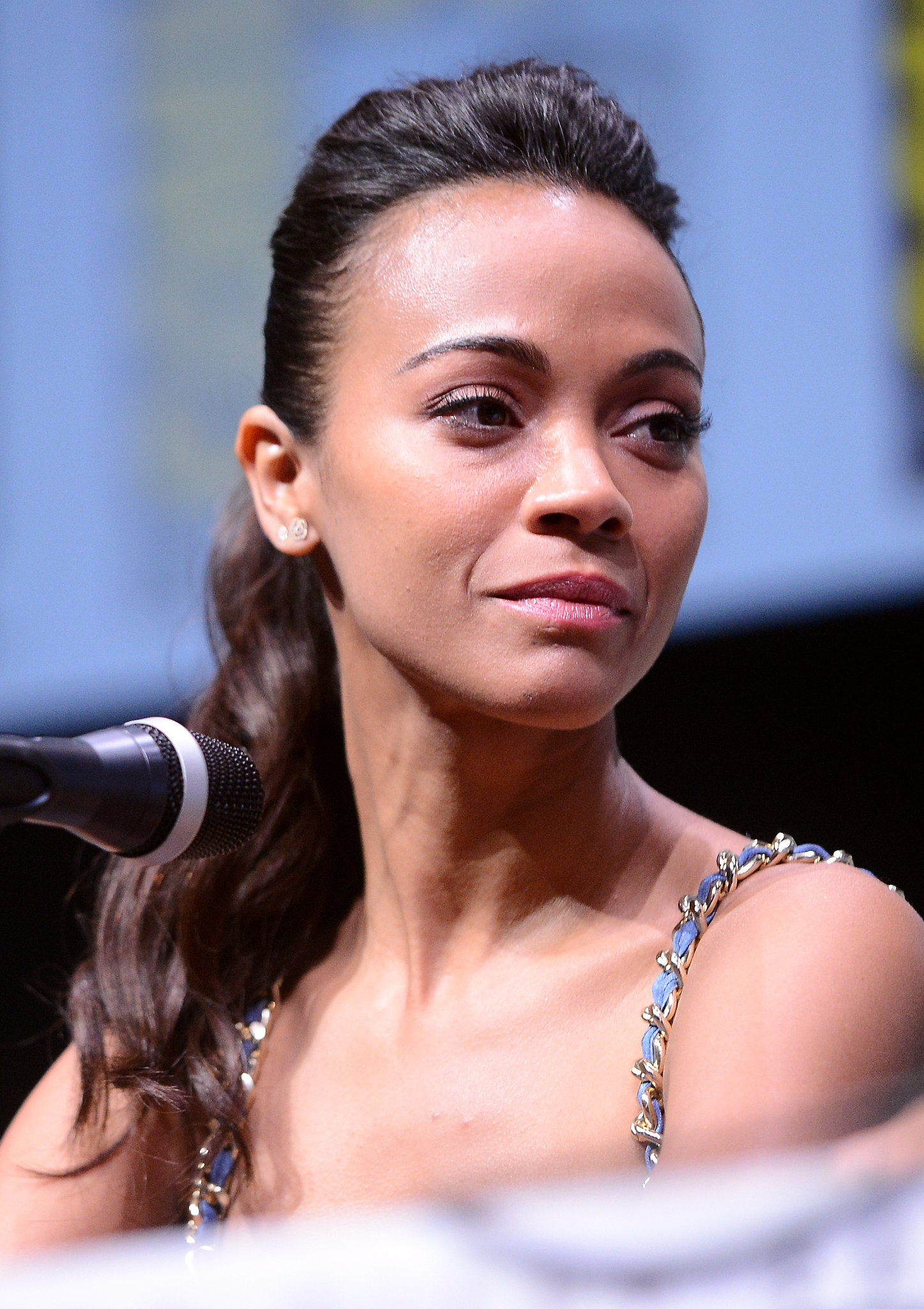 Zoe Saldana's high-volume ponytail and pink lipstick gave off a seriously edgy vibe at the panel for Marvel Studios.