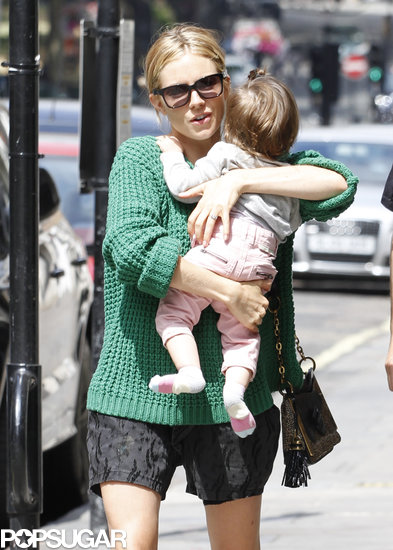 Sienna Miller held on to her daughter, Marlowe Sturridge.