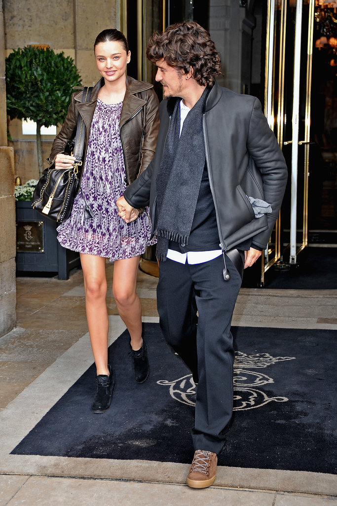 Miranda Kerr and Orlando Bloom leave the Balenciaga Ready to Wear Spring Summer 2011 show during Paris Fashion Week.