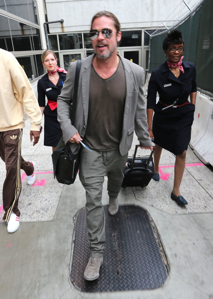 Brad Pitt walked with flight attendants.