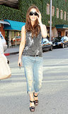 Kate showed off her cool-girl prowess in a tie-dye Helmut Lang tank, tattered Current/Elliott jeans, and ankle-strap sandals in Beverly Hills in 2009.