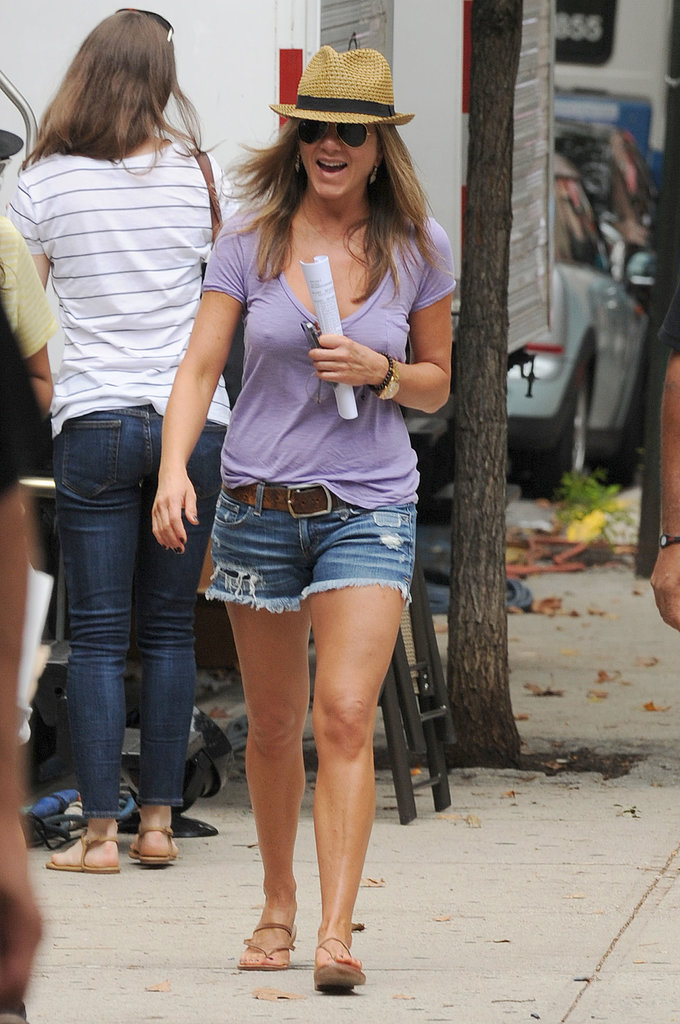 Jennifer Aniston showed off her legs in cutoffs as she arrived on the NYC set of Squirrels to the Nuts.