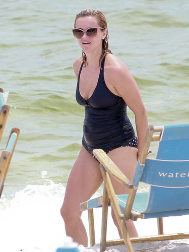 Reese Witherspoon matched pink cat-eye sunglasses with a black tankini and polka-dot bottoms in Florida.