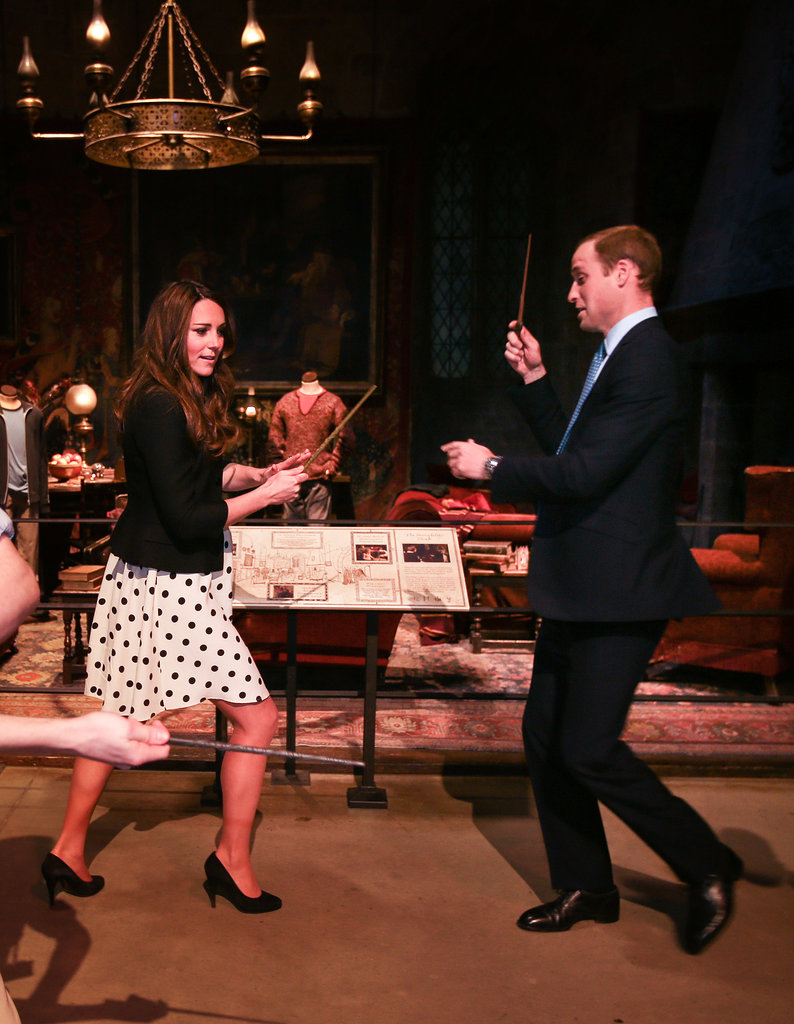 The cute couple pretended to challenge each other with Harry Potter wands at the opening of Warner Bros. Studios Leavesden in London in April 2013.