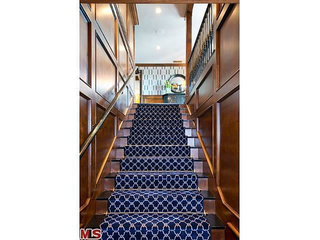 A patterned runner has the same effect on this beautiful staircase.