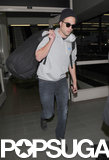 "Robert Pattinson Lands in LA as ""Seductive"" New Dior Teases Come Out"