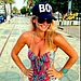 "Bar Refaeli paired her printed swimsuit with a ""Boy"" baseball cap.
