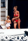 Nicole Richie wore a bright red bikini while on vacation in Sardinia, Italy, with her family.
