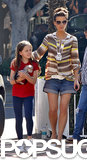 For a September 2009 shopping trip with Lily, Beckinsale dressed up her denim shorts with a striped blouse and elongating white pumps.