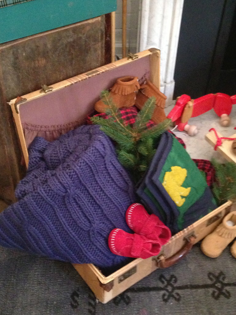 A suitcase full of treasures — Minnetonka moccasins, a cable-knit blanket . . . we almost forgot it was 90 degrees outside!