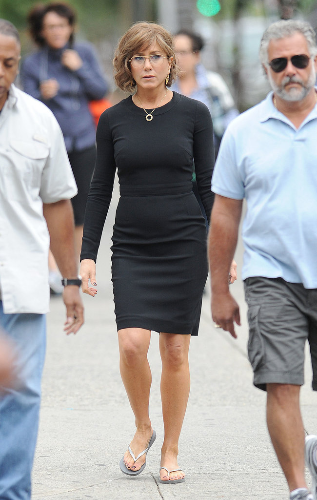 Jennifer Aniston wore a figure-hugging black dress on July 25.