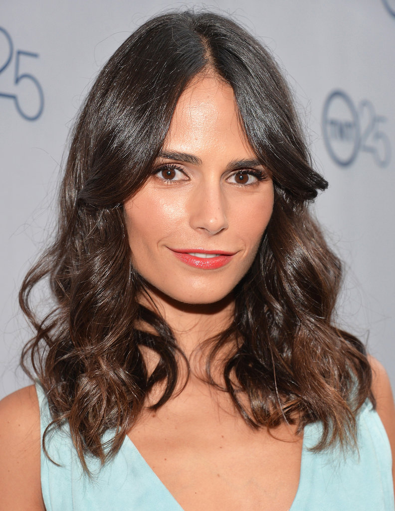 For her appearance at TNT's 25th Anniversary Party, Jordana Brewster wore her hair in glossy waves with a middle part. She kept her makeup simple with a splash of color on her lips.
