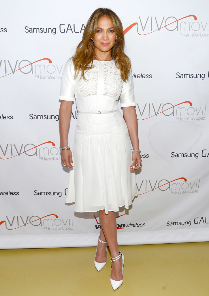 Jennifer Lopez traded her sexier wares for this ladylike white Elie Saab dress for the Viva Movil by Jennifer Lopez flagship store opening in New York's Brooklyn borough.