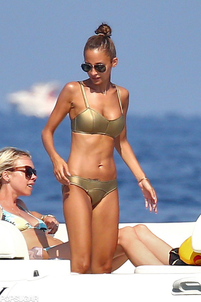 Nicole Richie wore a gold bikini on vacation on Friday.