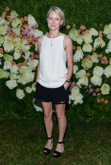 Naomi Watts wore black shorts and sandals.