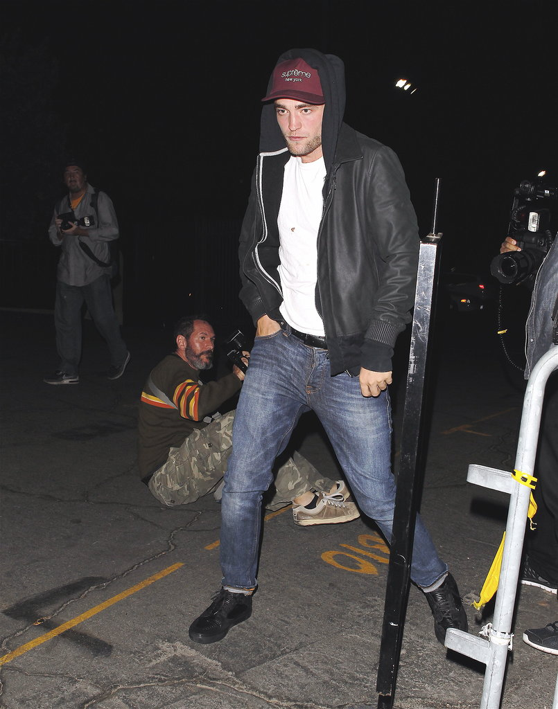 Robert Pattinson wore jeans and a jacket.