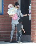 Sandra Bullock carried a birthday present on the way into a party with her son, Louis.