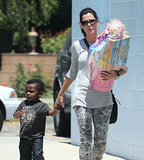 Sandra Bullock held hands with her son, Louis, on their way to a birthday party on Sunday in LA.