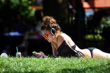 In New York City, a young woman worked on her tan.