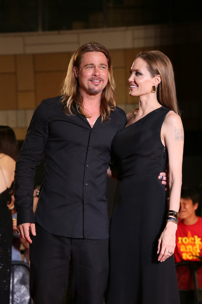 Angelina Jolie smiled at Brad Pitt.