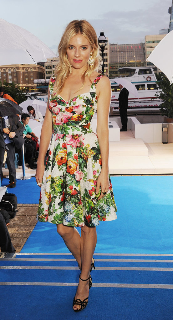 Sienna Miller helped unveil BMW's first electric car in a playful floral Dolce & Gabbana dress.