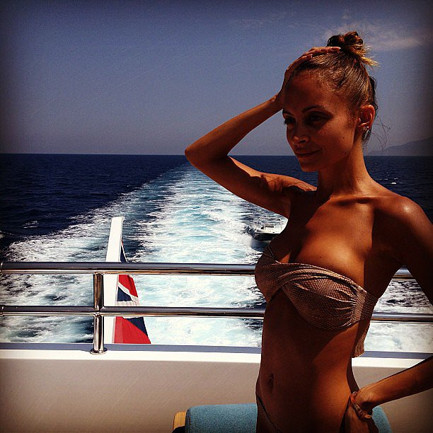 A topknot, bandeau bikini, and bronzed glow made Nicole Richie's boat ride more stylish than average.  Source: Instagram user nicolerichie