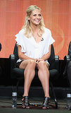 Sarah Michelle Gellar completed her panel look with a ruffled, white LA'T by L'Agence blouse, leather bottoms, and studded cage heels.