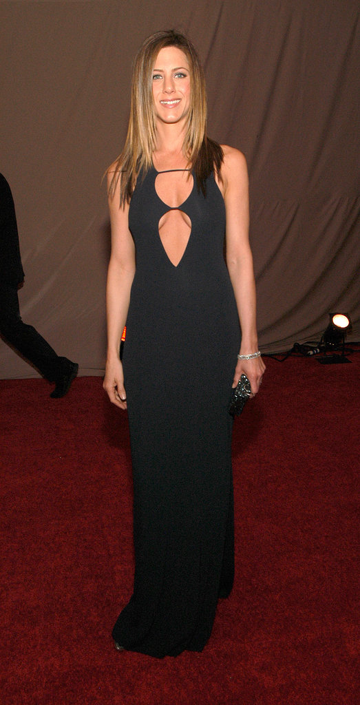 For the 2003 SAG Awards, Jennifer Aniston worked a subtly sexy double-cutout gown with silver metallic peep-toes and a few glistening accessories.