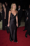Knotted strap detail, a ruched bodice, and low-cut neckline added major intrigue to Jennifer Aniston's black satin gown at the People's Choice Awards in 2001.