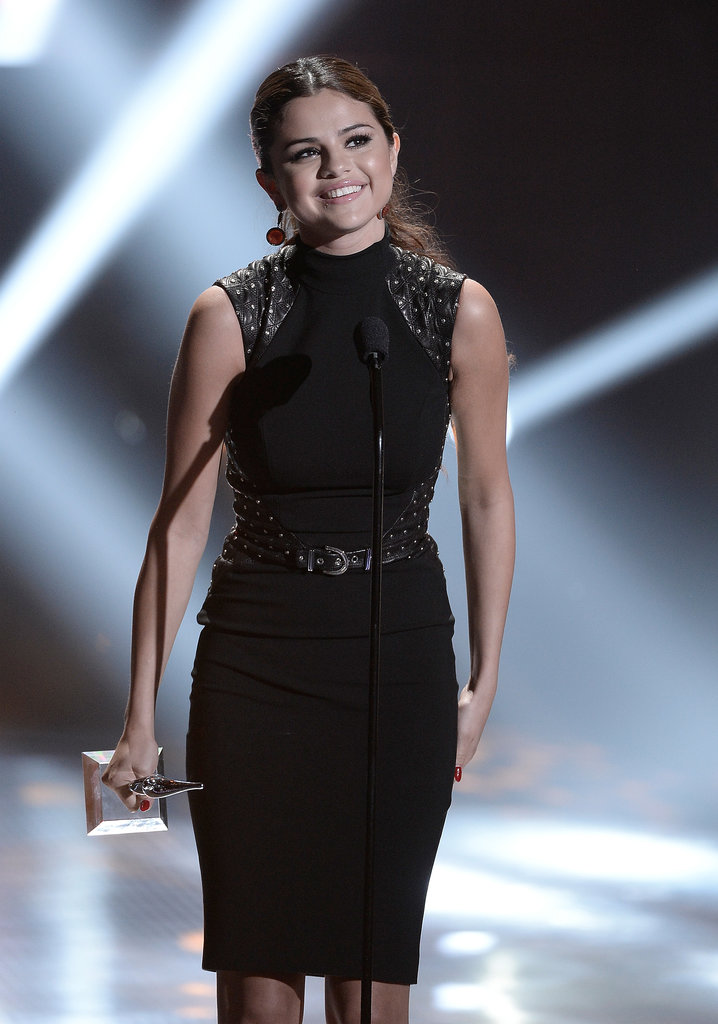 Selena Gomez flashed a smile when she accepted her award on stage at the Young Hollywood Awards.