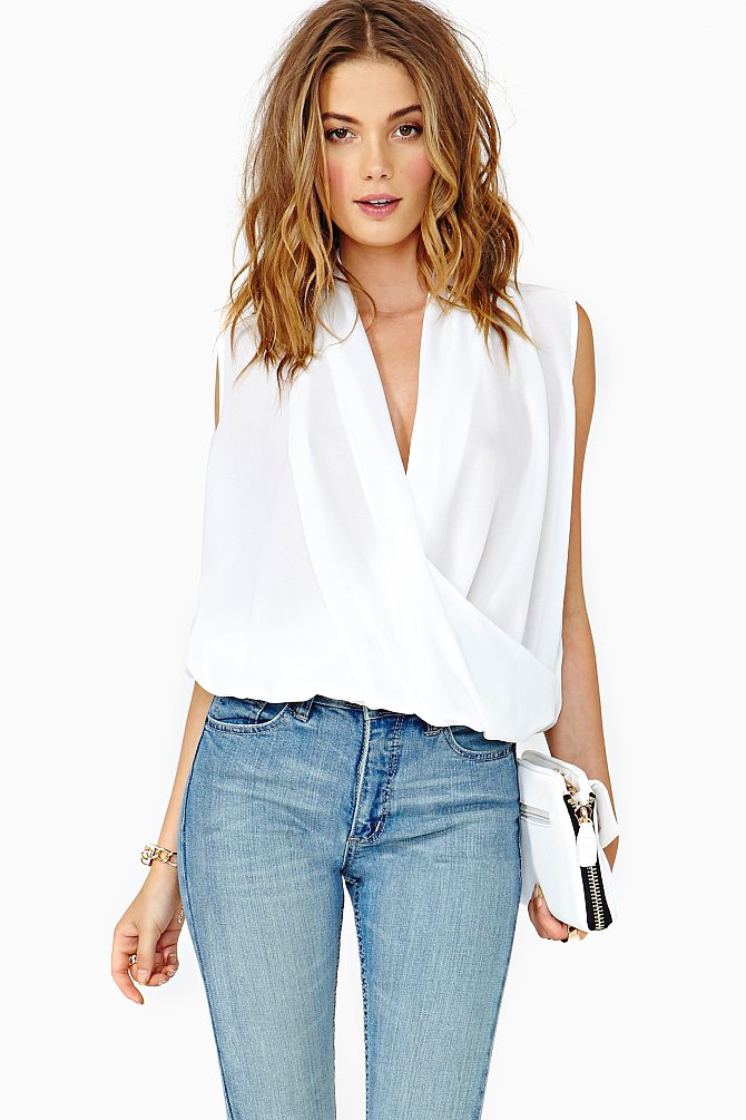 Under a tailored jacket, this Nasty Gal wrap top ($48) will lay beautifully.