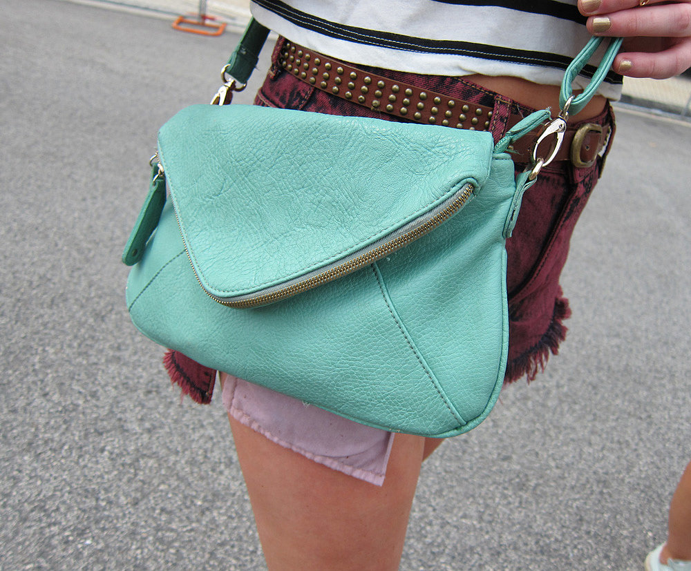 Pop of color! A minty teal Urban Outfitters bag brightens any outfit.