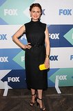 Emily Deschanel followed a similar path to her sister at the Fox All-Star party, pairing a black outfit with a bold yellow clutch.
