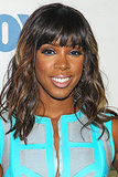 Kelly Rowland had heads turning in her practically neon blue dress at a Fox party. She kept with the colour scheme with a swipe of bright blue eyeliner on her lower lash line. Her hair was styled in beach waves with hints of blonde highlights.