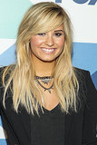 Demi Lovato showed off her blond hair with a bedhead texture and long sideswept bangs.