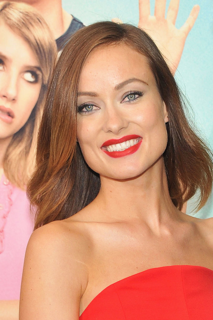 On the arm of her man Jason Sudeikis at the We're the Millers premiere, Olivia Wilde was a lady in red, from her dress to her matching lipstick.