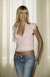 In September 2003, Charlize Theron attended a press event in London in a pink top and low-cut jeans.