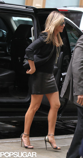 Jennifer Aniston wore a black leather skirt.