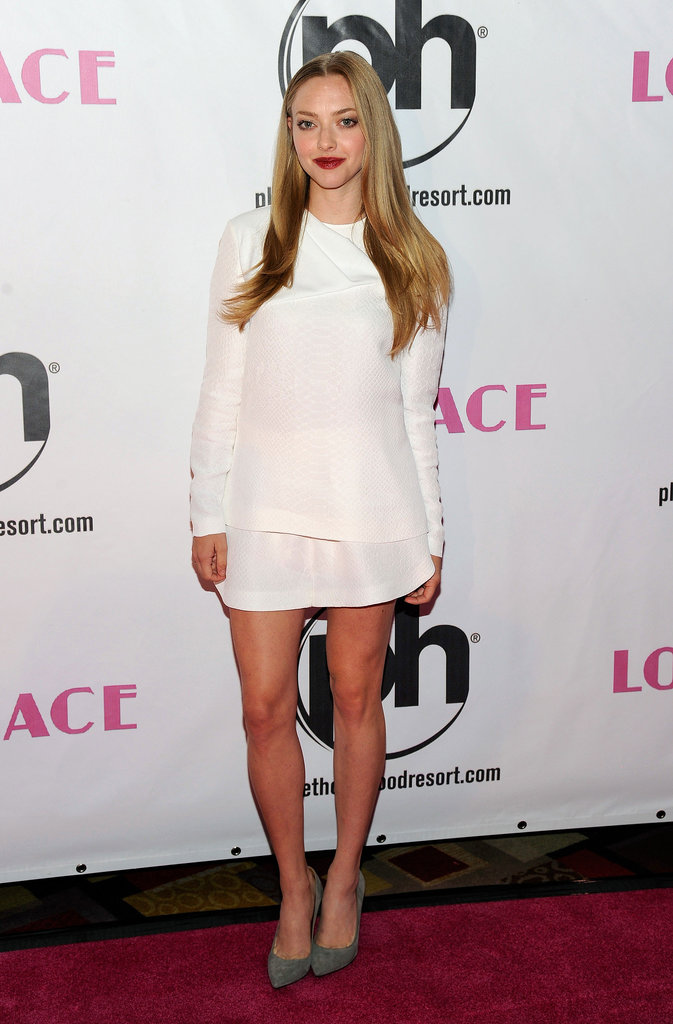 Amanda put her stems on display in this white Stella McCartney minidress and pumps at the Vegas premiere.