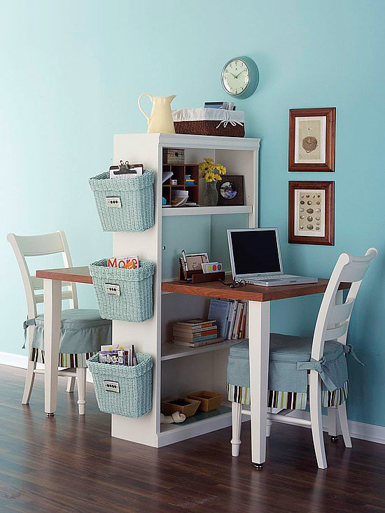 If space is a concern, consider going double-sided. This workspace, made from a bookcase, some fiberboard, and two pairs of legs, barely takes up any floor space. Source: Better Homes and Gardens