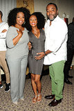 Oprah, pictured with actress and model Yaya DaCosta and director Lee Daniels, wore a gray sweater and trousers to a press conference about the film.