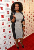 Oprah hosted an advanced screening of The Butler wearing a black-and-gray dress by Escada and earrings, bangles, and a cuff by Lorraine Schwartz.