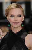 Channeling her role as the evil queen Ravenna in Snow White and the Huntsman, Charlize lined her eyes in black and kohl for the film's premiere. She finished off the look with a sleek, twisted updo.